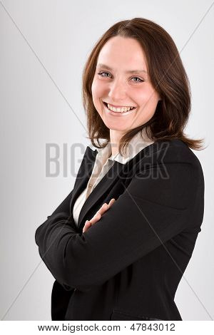 Smiling Business Woman On Gray