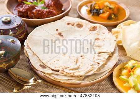 Chapati, Chapatti or Flat bread and Indian dhal curry, famous Singapore Indian food. poster