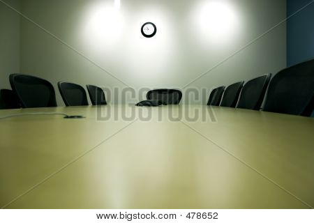 conference room with a table and empty chairs
