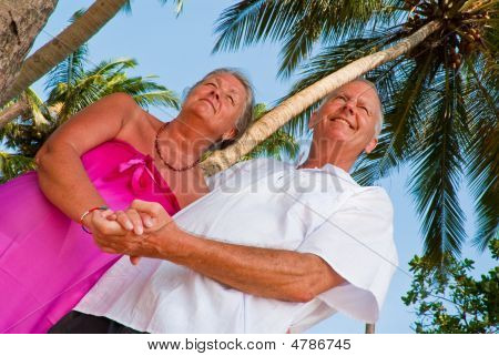 Happy Mature Couple Holding Hands