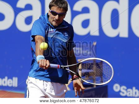 BARCELONA - APRIL, 24: Spanish tennis player Tommy Robredo in action during a match of Barcelona tennis tournament Conde de Godo on April 24, 2013 in Barcelona