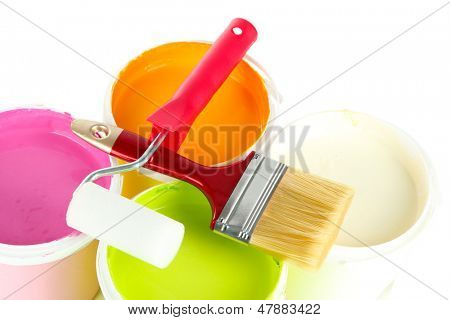 Set for painting: paint pots, brushes, paint-roller isolated on white