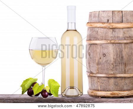 grapes on a barrel and wine glass