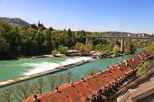 Cityscape of Bern (Switzerland) with arch bridge and old houses beside the Aare River poster