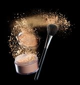 Isolated make-up powder with brush on black background poster
