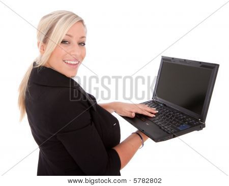 Beautiful Businesswoman Uses Laptop And Internet on white
