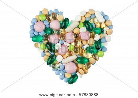 Heart shape made of color pills and capsules