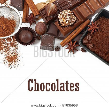Chocolate and spices isolated on white background