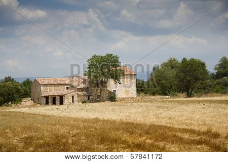 Lonely house stands in the middle of a field in Provence