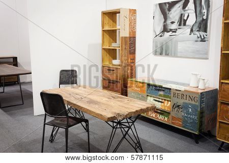 Wooden Table With Chairs On Display At Homi, Home International Show In Milan, Italy