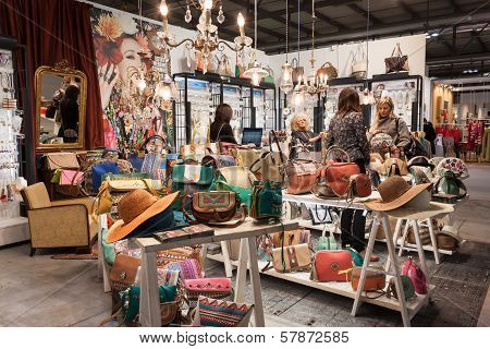 Women Visiting A Stand Displaying Bags At Homi, Home International Show In Milan, Italy