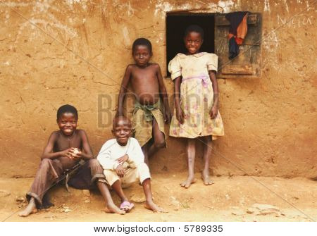 Poor Uganda children hanging around outside of home