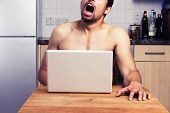 Young Naked Man Watching Porn In His Kitchen poster