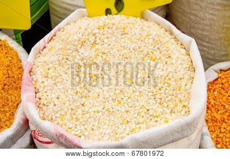 Cracked Corn Kernels In A Sack