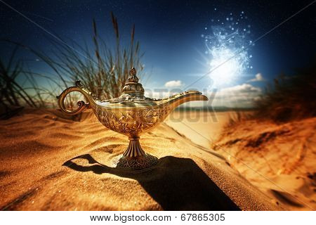 Magic lamp in the desert from the story of Aladdin with Genie appearing in blue smoke concept for wishing, luck and magic poster