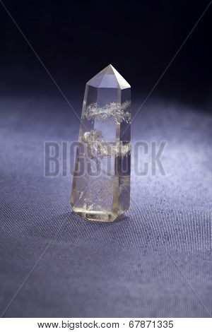 Quartz mineral ( rock) crystal) on a grey background poster