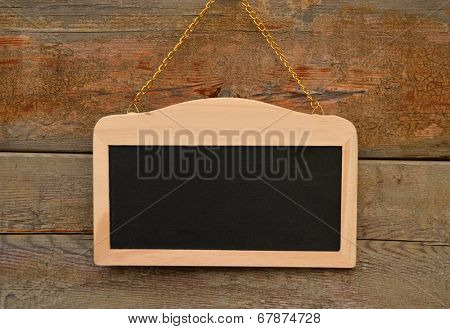 Small school wooden blank blackboard isolated on wood background