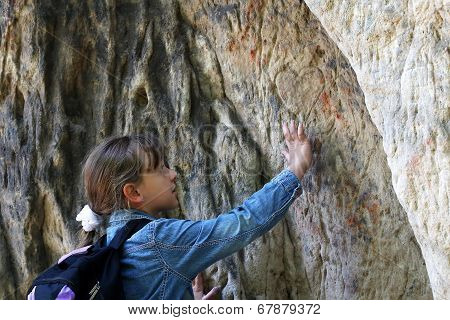 Girl Touch A Granite Rock Outdoors