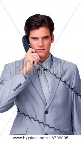 Upset Businessman Tangle Up In Phone Wires