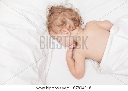 Restful Two Years Old Baby Girl Sleeping On Bed