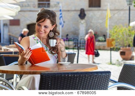 Young woman is sitting in the cafe