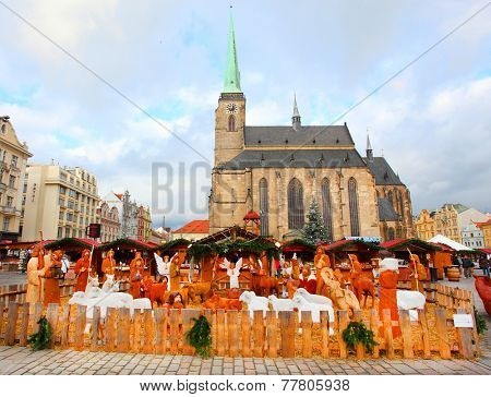 PILSEN CZECH REPUBLIC - DECEMBER 8, 2014: Artistic wooden Bethlehem Holy family on the Christmas market in the city center. It is Czech's traditional handicraft with a very long history.