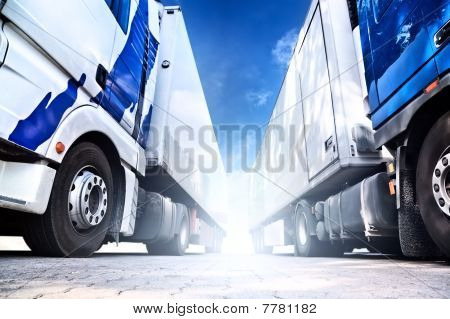 Two big trucks. Wide angle view . poster