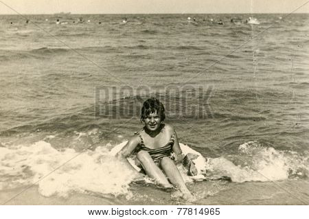 GERMANY, CIRCA 1940s: Vintage photo of woman on beach