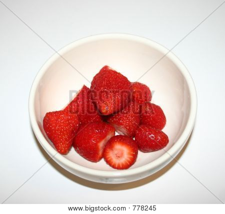 Bowl of fresh strawberries on white