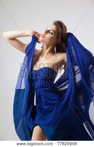Sexy woman in fluttering blue dress