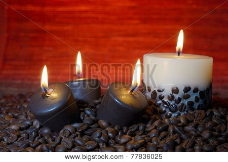 coffee beans and burning candles