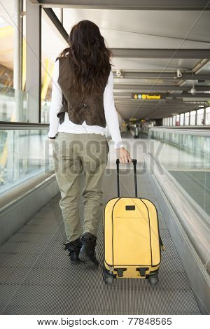Woman With Vest At Walkway Airport