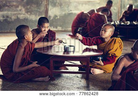 NYAUNGSHWE, MYANMAR - FEB 2: Young buddhist monk has the scanty dinner in Shwe Yan Pyay monastry, Inle Lake on February 2, 2011 in Nyaungswe, Myanmar.