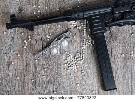 Airsoft Gun With Glasses And Lot Of Bullets