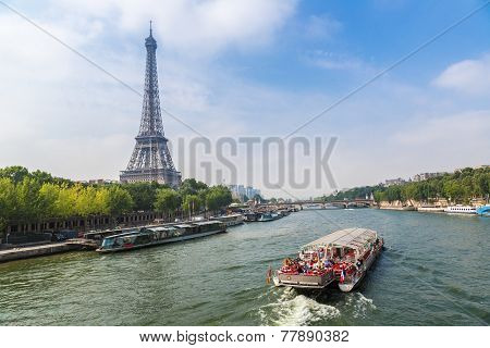 PARIS FRANCE - JULY 14 2014: Seine in Paris and Eiffel tower in beautiful summer day in Paris July 14 2014 poster