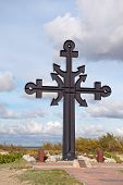 Cross in Rewa Cape Poland. Established to commemorate fishermen and sailors who never returned from the sea. poster