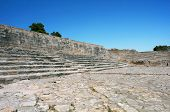 Ruins of Phaestus on Crete island supposedly an ancient theater against blue sky background.. poster