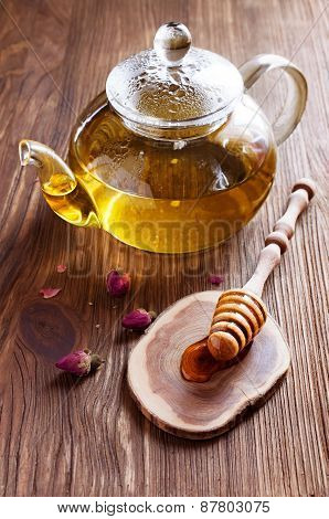 Tea In A Glass Teapot With Honey And Roses