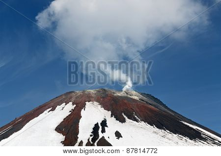 Avacha Volcano - active volcano of Kamchatka Peninsula. View of top of volcanic cone fumarolic activity of volcano: steam and gas emissions from crater. Russia Far East. poster