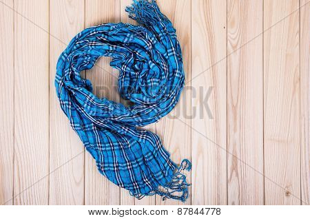 Blue Checkered Scarf On A Wooden Background