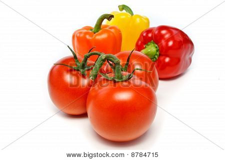 Three Bell Peppers And Three Tomatoes