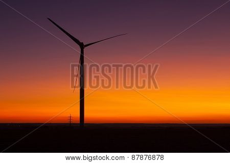 Windfarm At Sunset And Sky With Dust From Volcano