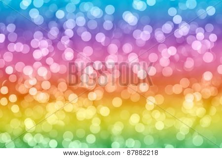 Rainbow Colorful Background With Natural Bokeh Defocused Sparkling Lights. Bright And Vivid Texture