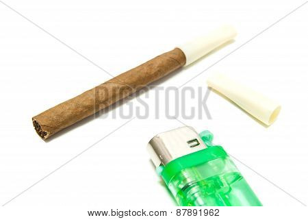 Cigarillo And Lighter On White
