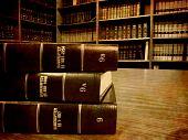 Old antique legal books on shelf or desk poster