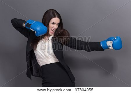 Business lady in boxing gloves