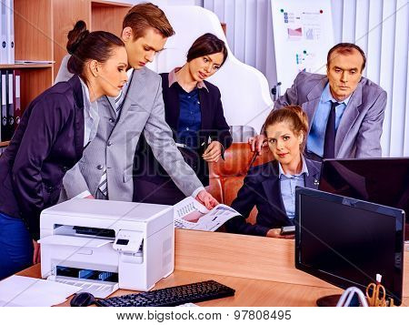 Happy group business people with printer in office.