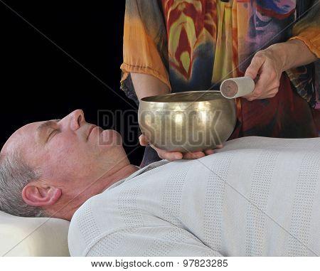 Sound Healer working with Tibetan Singing Bowl