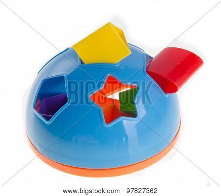 Shape Sorter. Childs Toy Shape Sorter On A Background