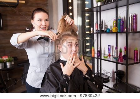 Young woman with a shocked expression in  hairdressing salon